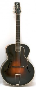 black and brown acoustic archtop guitar